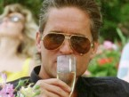 Gordon Gekko (Michael Douglas) wearing the Cartier Vendome Santos sunglasses in Wall Street.