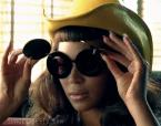 Beyonce with Linda Farrow Jeremy Scott Mickey Mouse sunglasses in Telephone