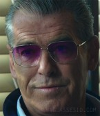 Pierce Brosnan wears Oliver Peoples Clifton sunglasses with pink gradient lens in Urge