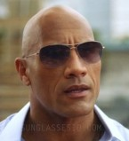 Dwayne Johnson (The Rock) wears Oliver Peoples Strummer sunglasses in Season 1, Episode 2 of the HBO tv series Ballers.