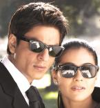 Shahrukh Khan and Kajol wear black Ray-Ban 2140 Wayfarer sunglasses on the set o
