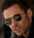 Hugh Jackman wears Ray-Ban 3030 Outdoorsman sunglasses in Eddie The Eagle.