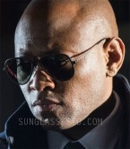 Omar Epps wears a pair of Ray-Ban RB4211 Aviator Light Ray II sunglasses in the TV series Shooter.