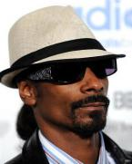 Snoop Dogg wearing black Serious Pimp OG Bandana sunglasses