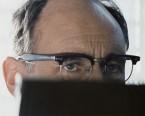 In Bridge of Spies, actor Mark Rylance wears a pair of Shuron Ronsir Zyl Black Briar Taper Temple eyeglasses.