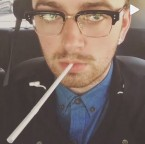 Sam Smith wearing Dita Statesman eyeglasses
