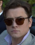 Taron Egerton wears vintage Persol sunglasses in Billionaire Boys Club.