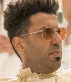 Adeel Akhtar wears Ray-Ban RB3447 Round Metal sunglasses in the 2019 Netflix film Murder Mystery.