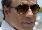 John Travolta wearing Ray-Ban Cats 5000 Classic RB4125 sunglasses in the movie Speed Kills.