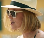 Charlize Theron wears a pair of white Saint Laurent SL1 sunglasses in the movie Long Shot