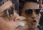 Bruno Mars wears gold sunglasses in the music video Uptown Funk