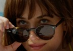 Dakota Johnson wears Ray-Ban RB2180 sunglasses in the 2018 movie Fifty Shades Freed.
