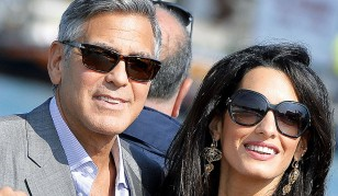 George Clooney and Amal Alamuddin during a trip on a water taxi in the canals of Venice during the wedding weekend