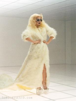 Lady Gaga, wearing white Carrera Champion sunglasses, presents her new video 'Ba