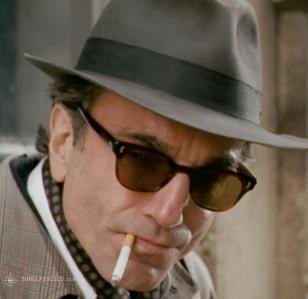 Daniel Day-Lewis wearing sunglasses in the movie Nine