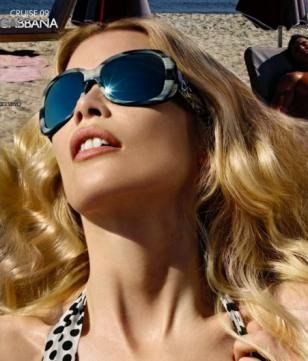 Claudia Schiffer wearing Dolce & Gabbana 4033 sunglasses in an advertisement for