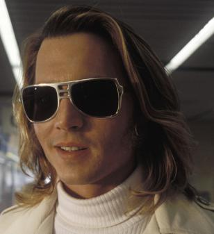 Johnny Depp, as George Jung, wearing the aluminium frame sunglasses in the movie