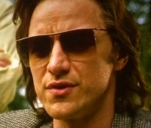 James McAvoy as Charles Xavier / Professor X wearing square rimless sunglasses in X-Men Apocalypse