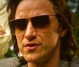 James McAvoy as Charles Xavier / Professor X wearing square rimless sunglasses in X-Men Apocalypse