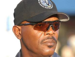 Samuel L. Jackson wears Oakley M Frame Hybrid sunglasses in the movie S.W.A.T.