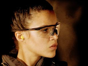 Michelle Rodriguez wearing Oakley M Frame glasses in the movie S.W.A.T.