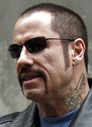 John Travolta wearing Oakley Square Wire in The Taking of Pelham 123