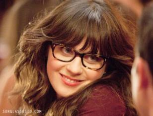 Zooey Deschanel (as Jess) wears a pair of Oliver Peoples Wacks eyeglasses in the