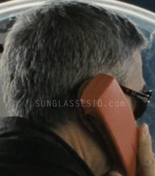 George Clooney wearing Persol 2883 sunglasses in the movie The American