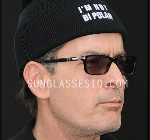 Charlie Sheen wears a Persol PO2965 eyeglasses frame fitted with tinted glasses.