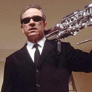 Tommy Lee Jones wearing Ray-Ban 2030 Predator sunglasses in Men in Black