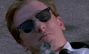Tim Roth wearing Ray-Ban 3016 Clubmaster sunglasses
