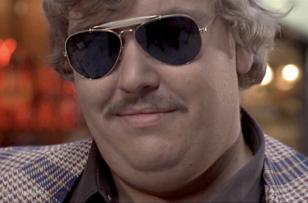 John Candy wearing Ray-Ban 3029 Outdoorsman sunglasses in The Blues Brothers