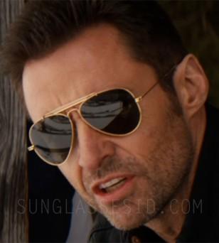 Hugh Jackman wears Ray-Ban 3030 Outdoorsman sunglasses in Eddie The Great.