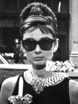 Audrey Hepburn wearing her famous Oliver Goldsmith sunglasses in the movie Break