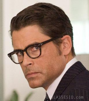 Rob Lowe wearing Shuron Freeway eyeglasses on a movie wallpaper