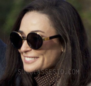 Demi Moore wears a pair of RetroSuperFuture Santa Black and gold sunglasses in the movie Blind.