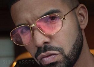 Drake wearing the solid gold Cartier Romance Louis Cartier sunglasses with pink lenses