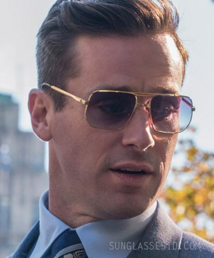 Armie Hammer wears gold sunglasses in On The Basis Of Sex (2019).