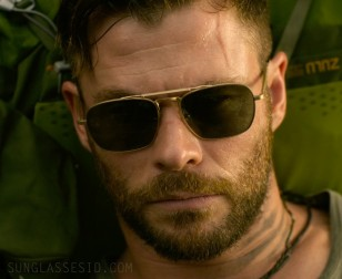 Chris Hemsworth wears an unidentified pair of gold sunglasses in Extraction.