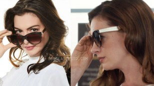 Anne Hathaway wears a pair of Havana sunglasses with gold legs in The Hustle.