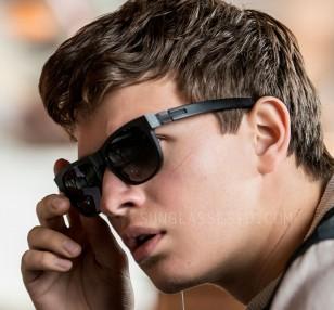 Ansel Elgort wears black ic! berlin Fahrlehrer Klaus sunglasses in Baby Driver.