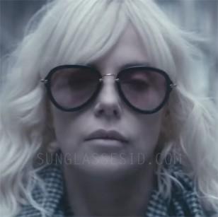 Charlize Theron wearing Miu Miu 03QS sunglasses in Atomic Blonde.