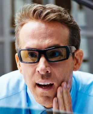 Ryan Reynolds wears black modified Oakley Gascan sunglasses in the movie Free Guy.