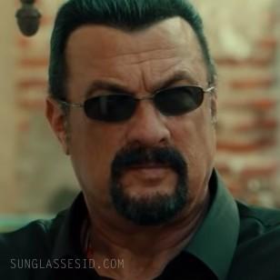 Steven Seagal wears Oakley Whisker sunglasses in General Commander