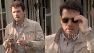 Matthew Settle wearing light havana Persol 0714 folding sunglasses and a Rolex w