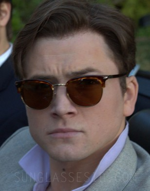 Taron Egerton wears vintage Persol sunglasses in Billionaire Boys Club.