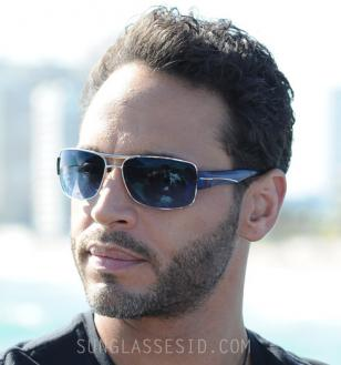 In Graceland, the main character Paul Briggs, played by Daniel Sunjata, wears a