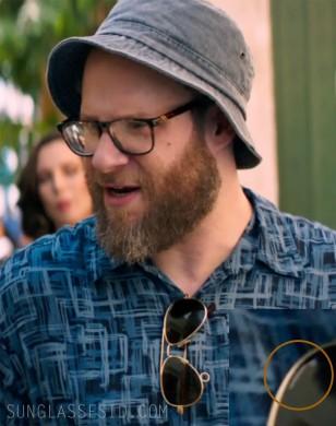 Randolph Engineering Concorde aviator sunglasses hanging on the shirt of Seth Rogen in the film Long Shot.
