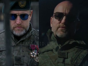 In War for the Planet of the Apes, Woody Harrelson wears black RE Aviator sunglasses which in the outdoor light seem to have blue lenses.