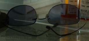 Close up of the light weight rimless sunglasses with flexible hingeless arms in The Last Movie Star.